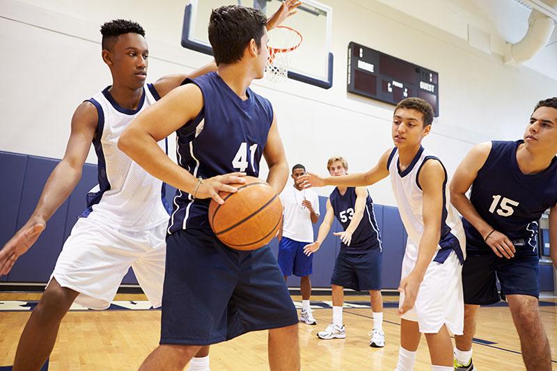 high school kids playing basketball